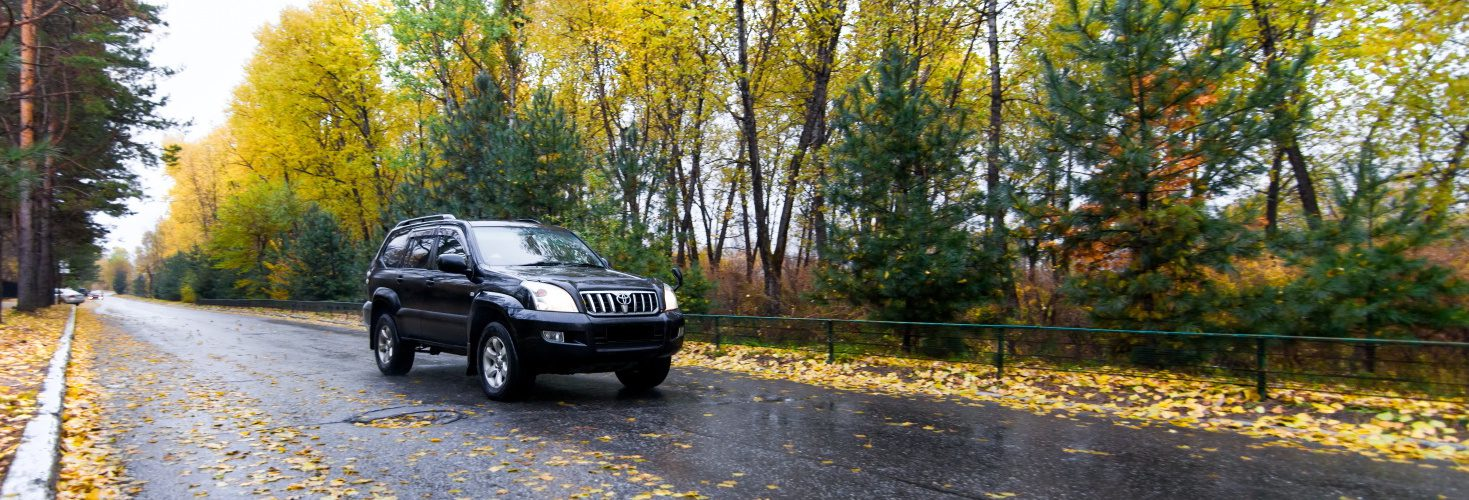 Toyota Prado on autumn road
