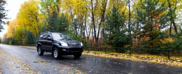 Toyota Prado on autumn road