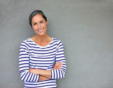 IDEAL Rechtsschutzversicherung: lächelnde Frau